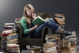 girl reading pile of books700